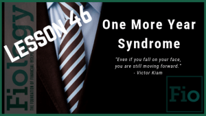 This is a header image for the Fiology Lesson One More Year Syndrome (OMY) - Should You Keep Working? It displays an image of a suit and tie, ready to go to work another day.
