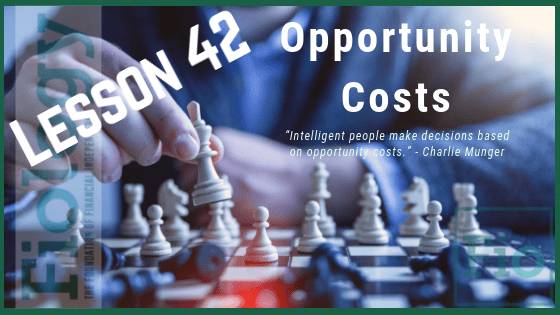 This is the header image for the Fiology lesson on Opportunity Cost - Everything In Life Is a Trade-Off. It depicts the title of the lesson and an image of a person moving chess pieces on a chess board.
